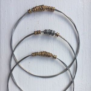 Bangle bracelets wire-type materials.